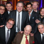 Top row from left - John Mayer, Jimmy Kimmel, Jeff Garlin, John Stamos, Jim Gaffigan, Jack Black. Seated from left - Bob Saget, Don and Brad Grey, chairman & CEO of Paramount Pictures. Beverly Hills, CA, June 2015.